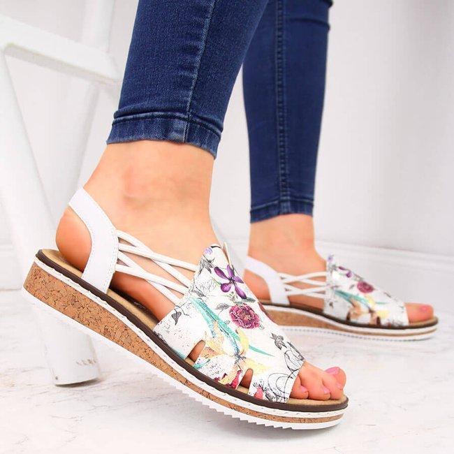 Sandały damskie w kwiaty na koturnie białe Rieker V36G2